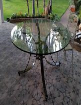 A round table, iron Smithery and glass