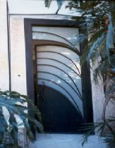 An iron door from metalworking with milky triplex glass