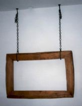 A wooden frame as a sculpted element for a wall