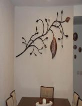 Decorated wall clock element, of metalwork iron and copper