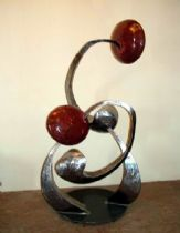statue, crafted in stainless steel volumes