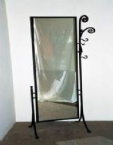 An iron mirror with hangers