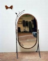 A standing mirror from iron
