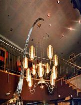 A bridge element, stainless steel chandelier from stainless steel and parchment