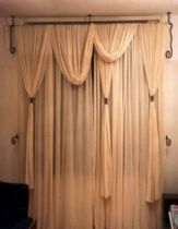 A carnice pole from iron and brass curtain wrapps from smithing work