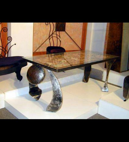 A dining iron and glass table