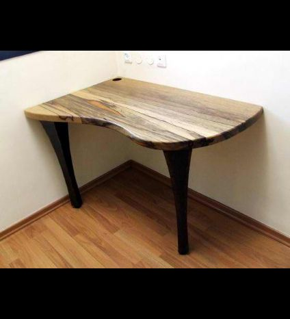 A brazillian nut wood writing table with metalworked legs