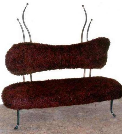 An iron bench with velvet padding
