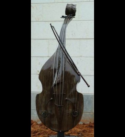The Cello sculpturemade of  metalworked iron,