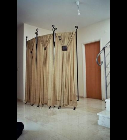 An iron partition with a cloth curtain